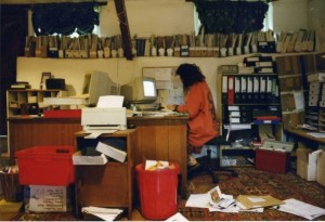 Sue Cameron at the desk of the Permaculture Association office, based at Chickenshack until 1999