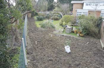 view of fence line before
